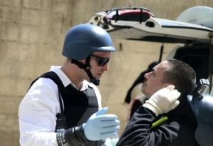 Inspecteurs de l'ONU enquêtant sur le site de l'attaque chimique, à Damas (photo Reuters - Mohamed Abdullah)